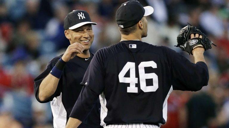 Derek Jeter talks to Andy Pettitte during a