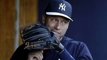 New York Yankees shortstop Derek Jeter adjusts the