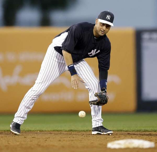 Yankees shortstop Derek Jeter fields a ball between