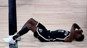 Brooklyn Nets' Caris LeVert reacts after inadvertently getting