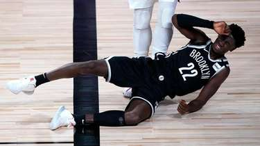 The Nets' Caris LeVert falls down after inadvertently