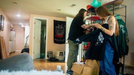 Colin Feeney and Julia DiMartino packing their Lindenhurst