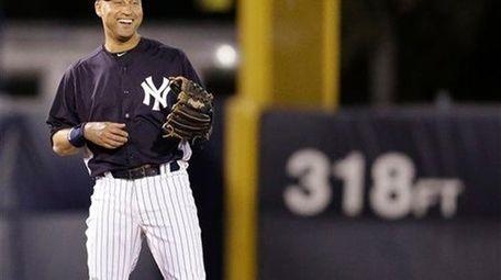 Derek Jeter smiles during the fourth inning of