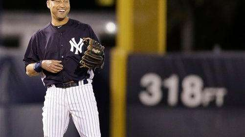 Derek Jeter smiles during the fourth inning of