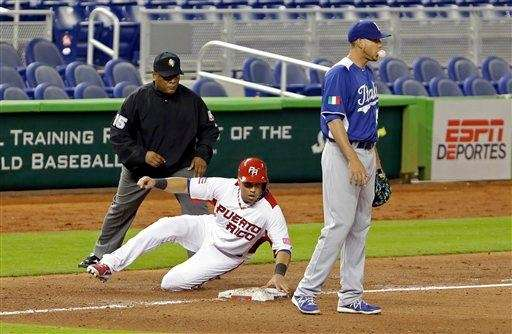Puerto Rico's Carlos Beltran slides safely into third