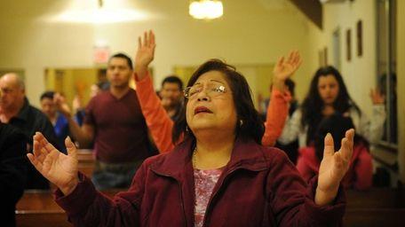 Violeta Torrejon from North Babylons pray during a