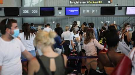 Passengers queued in line Friday at Nice airport