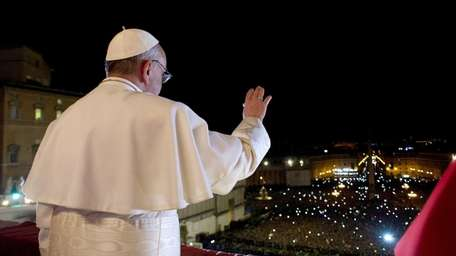 Newly elected Pope Francis I appears on the
