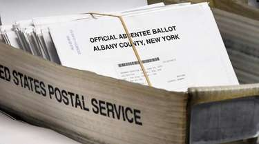 A box of absentee ballots wait to be