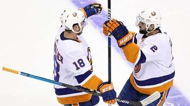 Nick Leddy of the Islanders is congratulated by