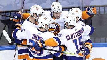 Matt Martin of the Islanders is congratulated by