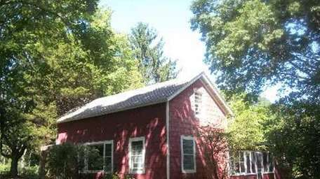 A circa 1867 Shelter Island farmhouse is on