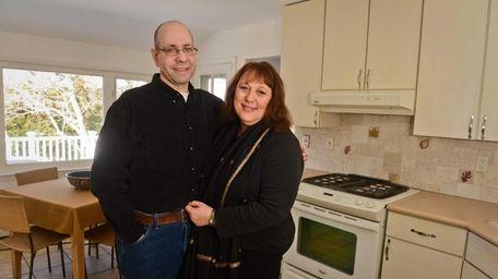 Caroline and Richard Bock inside the kitchen of