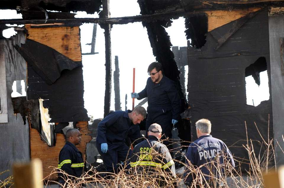 Investigators at scene of deadly fire at 218