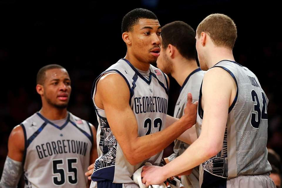 From left, Jabril Trawick #55, Otto Porter Jr.