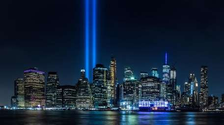 The Tribute in Light rises over lower Manhattan