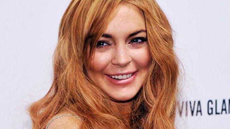 Lindsay Lohan attends the amfAR New York Gala