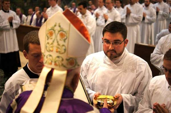 Andrew Garnett, a seminarian from Oyster Bay, at