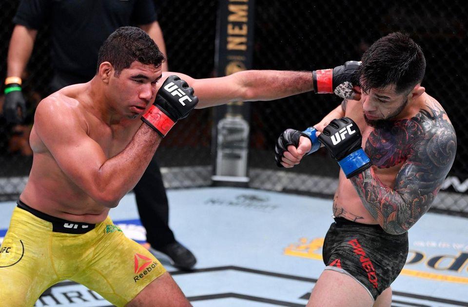 Herbert Burns (L) of Brazil punches Daniel Pineda