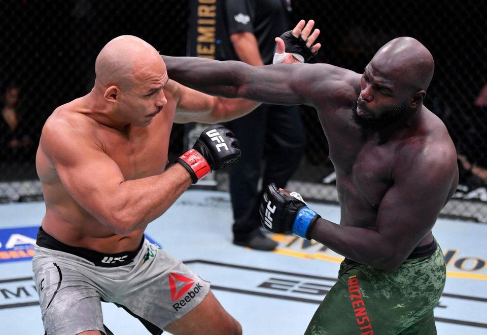Jairzinho Rozenstruik (R) of Suriname punches Junior Dos