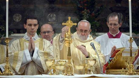 Pope Francis, center, Argentina's Jorge Mario Bergoglio, leads