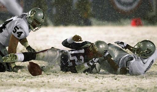 New England Patriots quarterback Tom Brady loses the