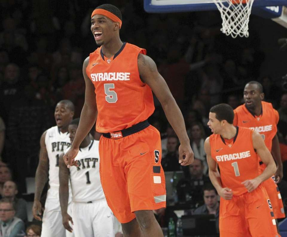 Syracuse's C.J. Fair reacts after scoring during the