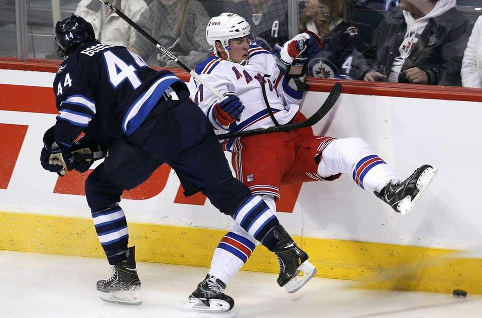 Jets' Zach Bogosian takes out the Rangers J.T.