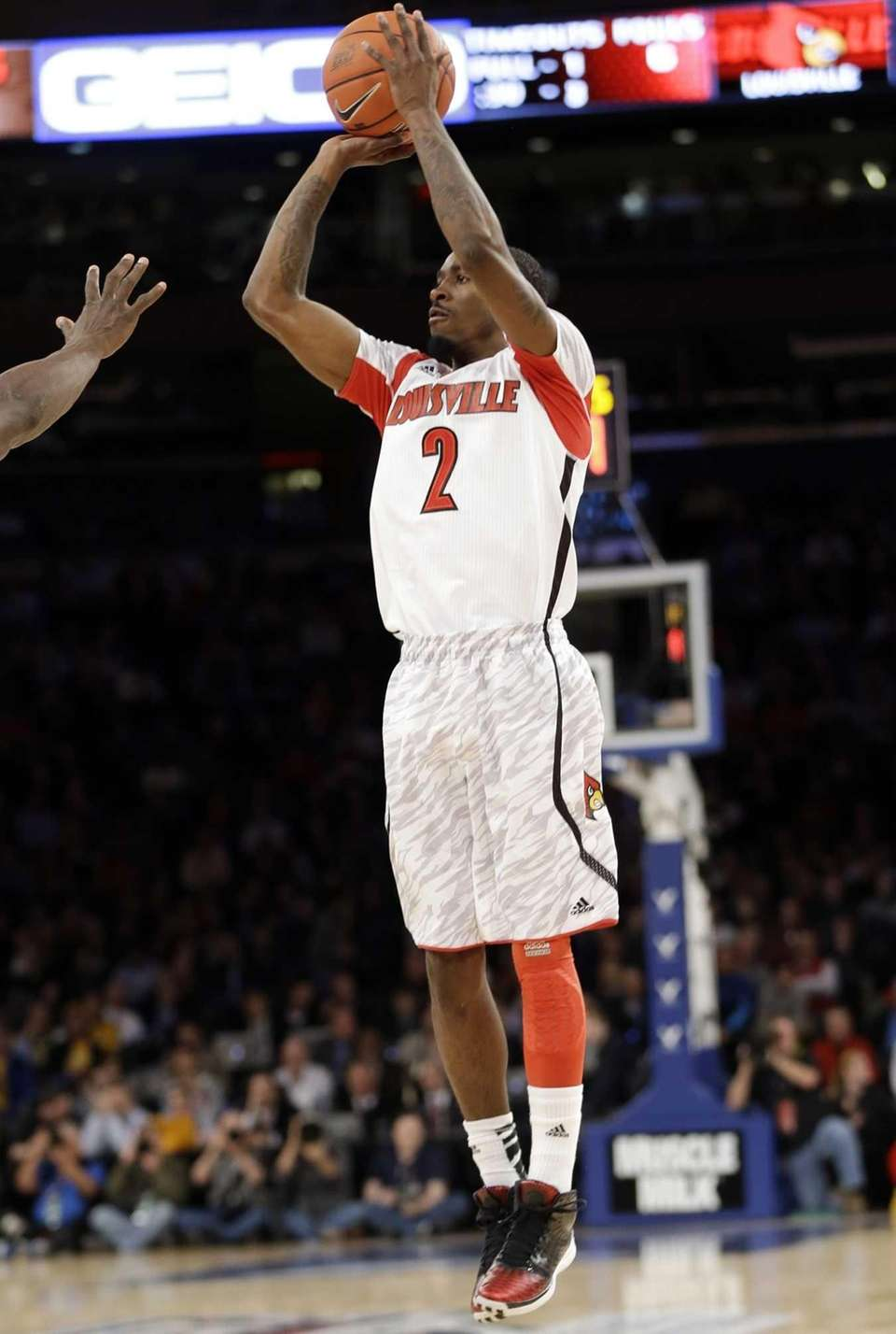 Louisville's Russ Smith shoots during the first half.