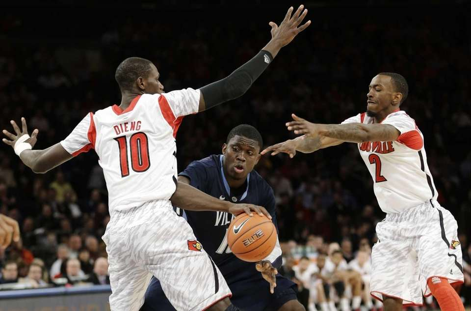 Villanova's Mouphtaou Yarou is defended by Louisville's Gorgui