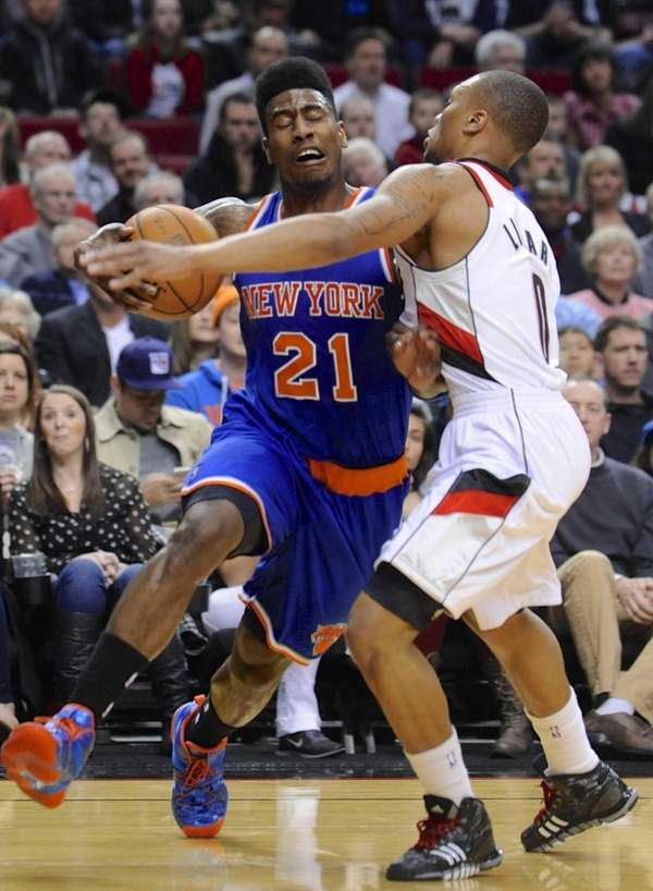 Knicks' Iman Shumpert drives against Portland Trail Blazers'