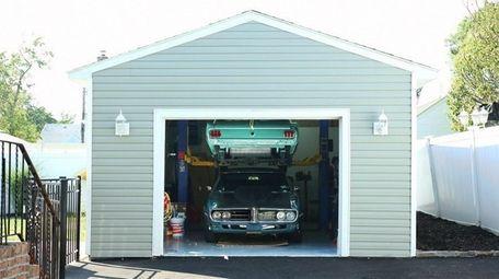 The garage has a car lift.