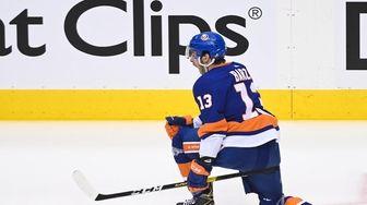 New York Islanders center Mathew Barzal (13) reacts