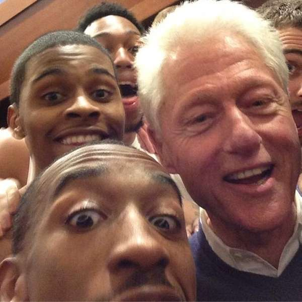 President Clinton celebrates with the Louisville Cardinals.