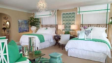 The richness of emerald can turn a bedroom