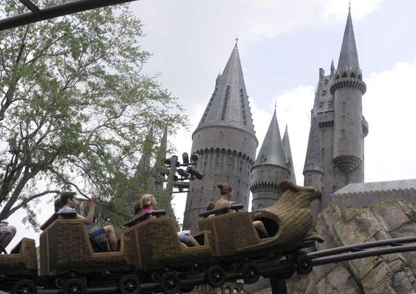 Guests ride on the Flight of the Hippogriff