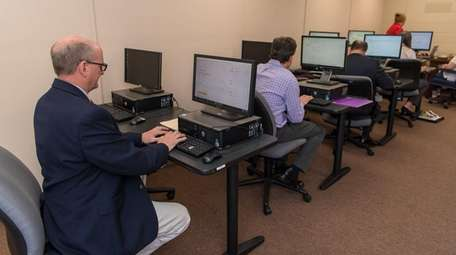 Jobseekers fill out an application at Suffolk County's