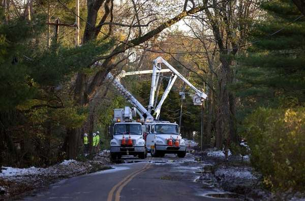 National Grid linemen work on replacing poles in