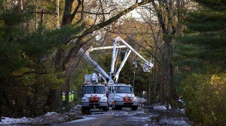 National Grid linemen work on replacing poles in