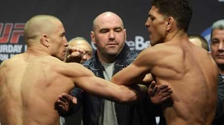 Georges St-Pierre, left, and Nick Diaz, right, are