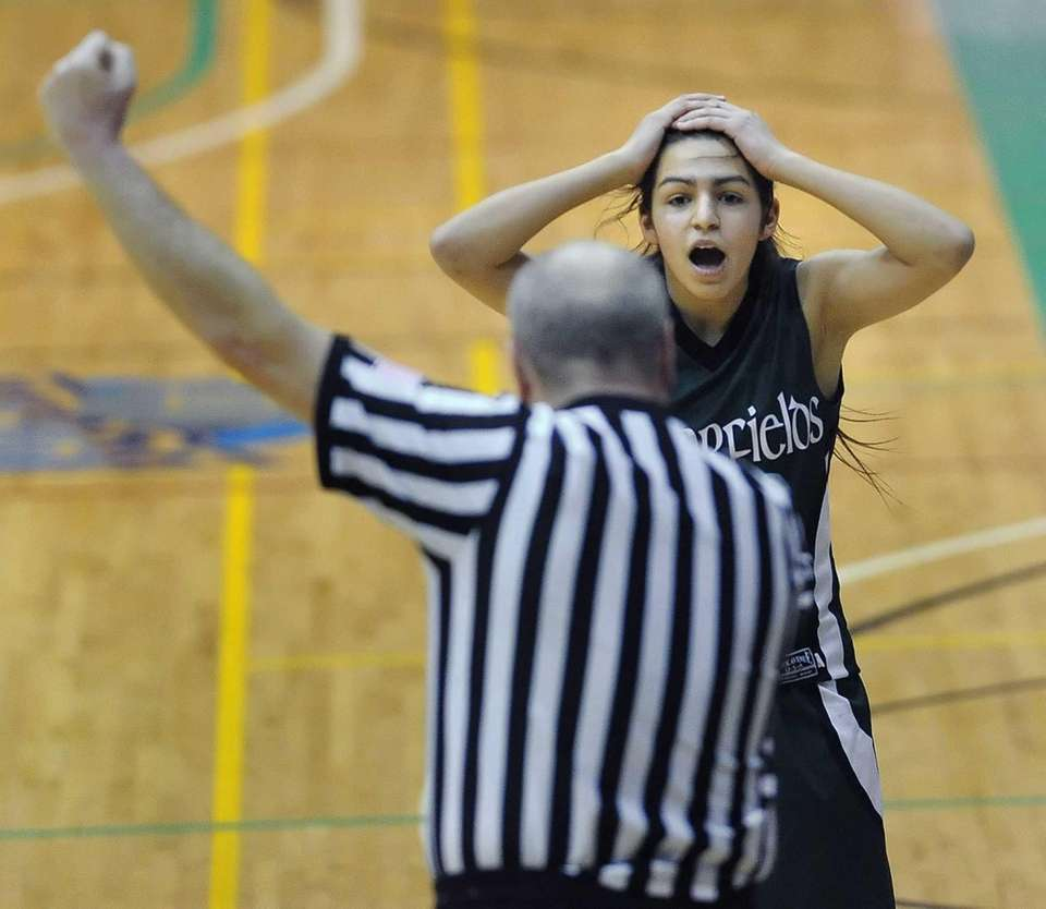 Harborfields' Amy Luxemberg, right, reacts to being called
