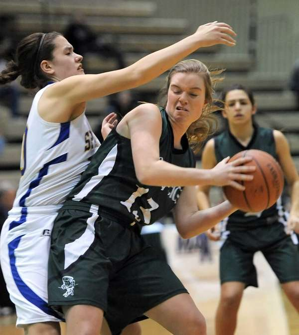 Harborfields' Amy Werbitsky, right, is defended by Maine-Endwell's
