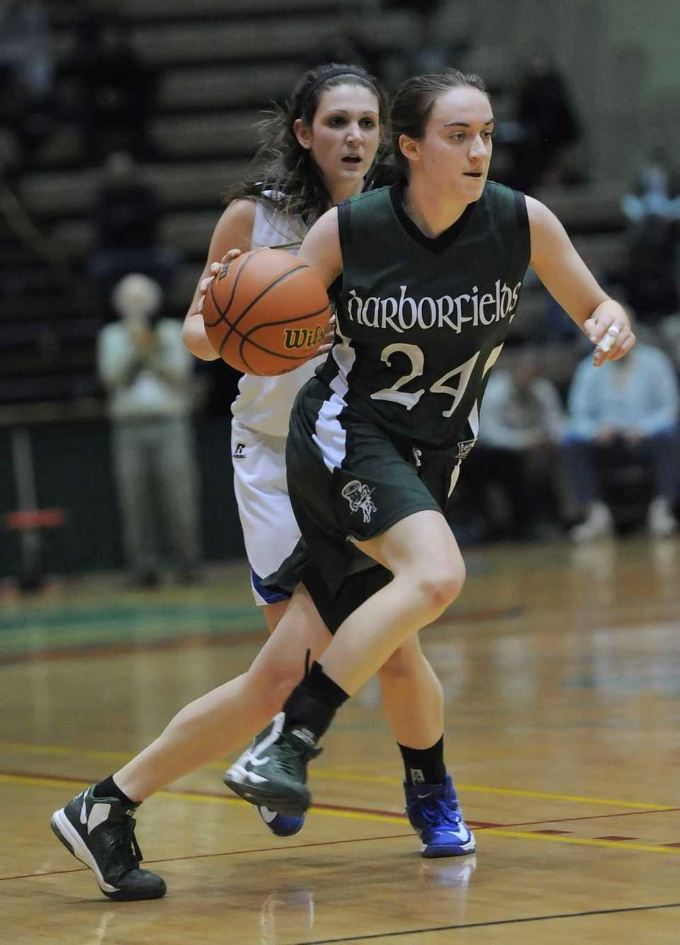 Harborfields' Bridgit Ryan carries the ball up court.