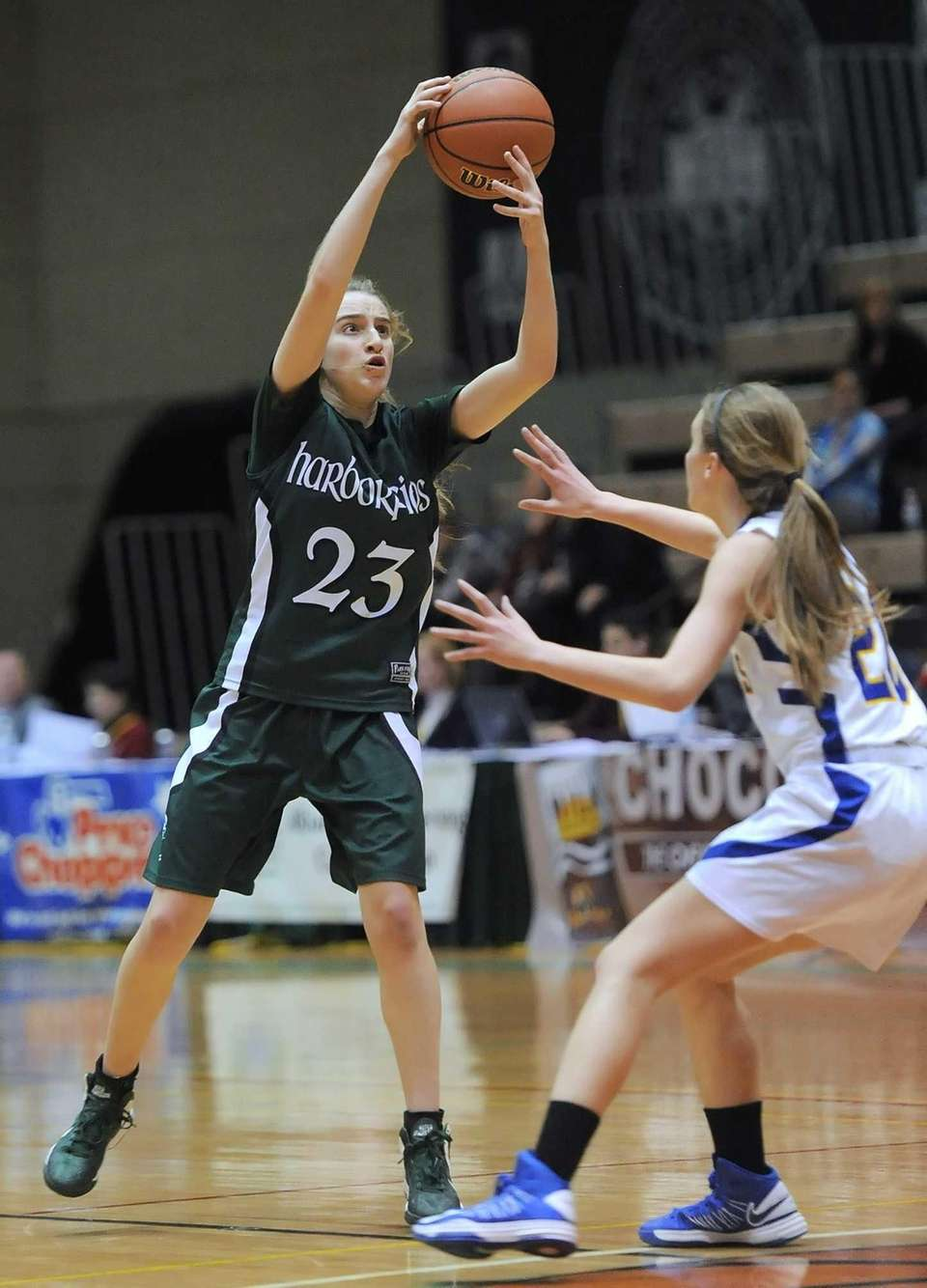 Harborfields' Toni Deren, left, reaches for a high