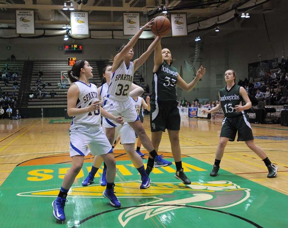 Harborfields' Jasmine White, right, reaches for a rebound
