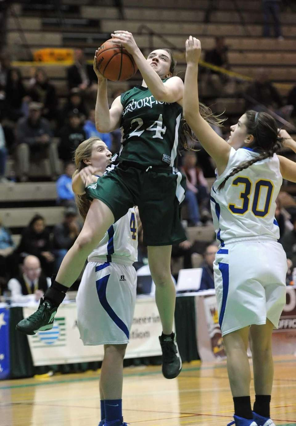 Harborfields' Bridgit Ryan drives the lane against Maine-Endwell's