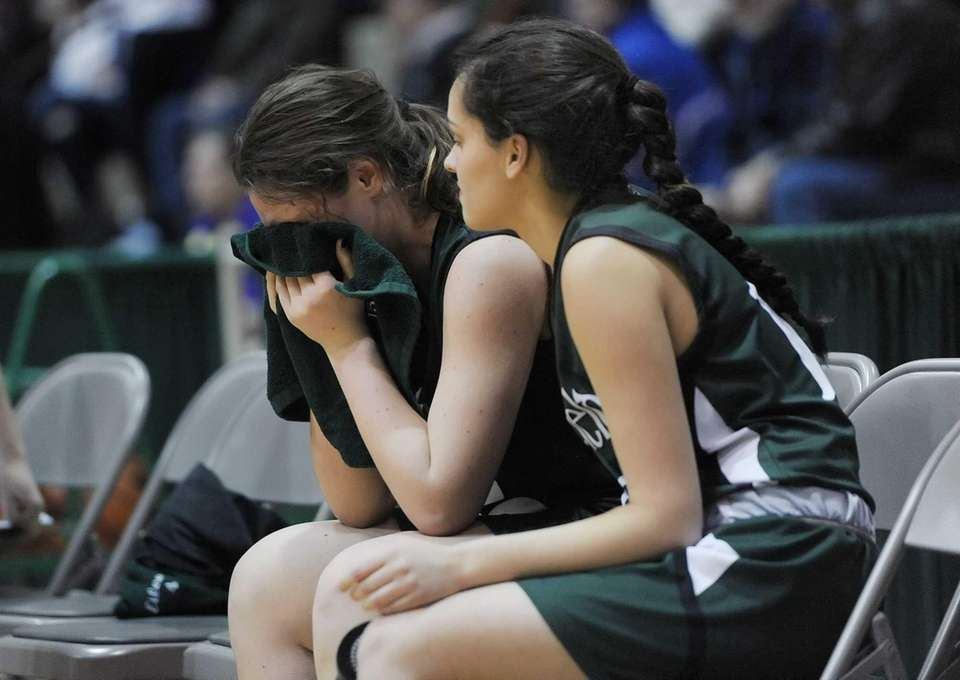 Harborfields' Kristen Kelly, left, is consoled by teammate