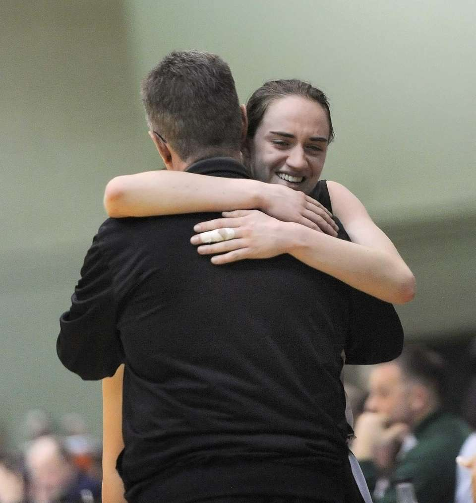 Harborfields' Bridgit Ryan hugs coach Russ Tietjen in