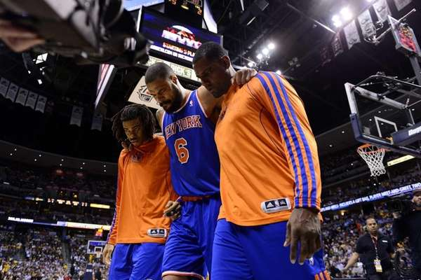 Tyson Chandler of the Knicks is helped off