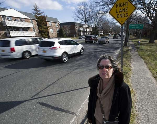 Mara Jacobowitz stands on Peninsula Boulevard just off